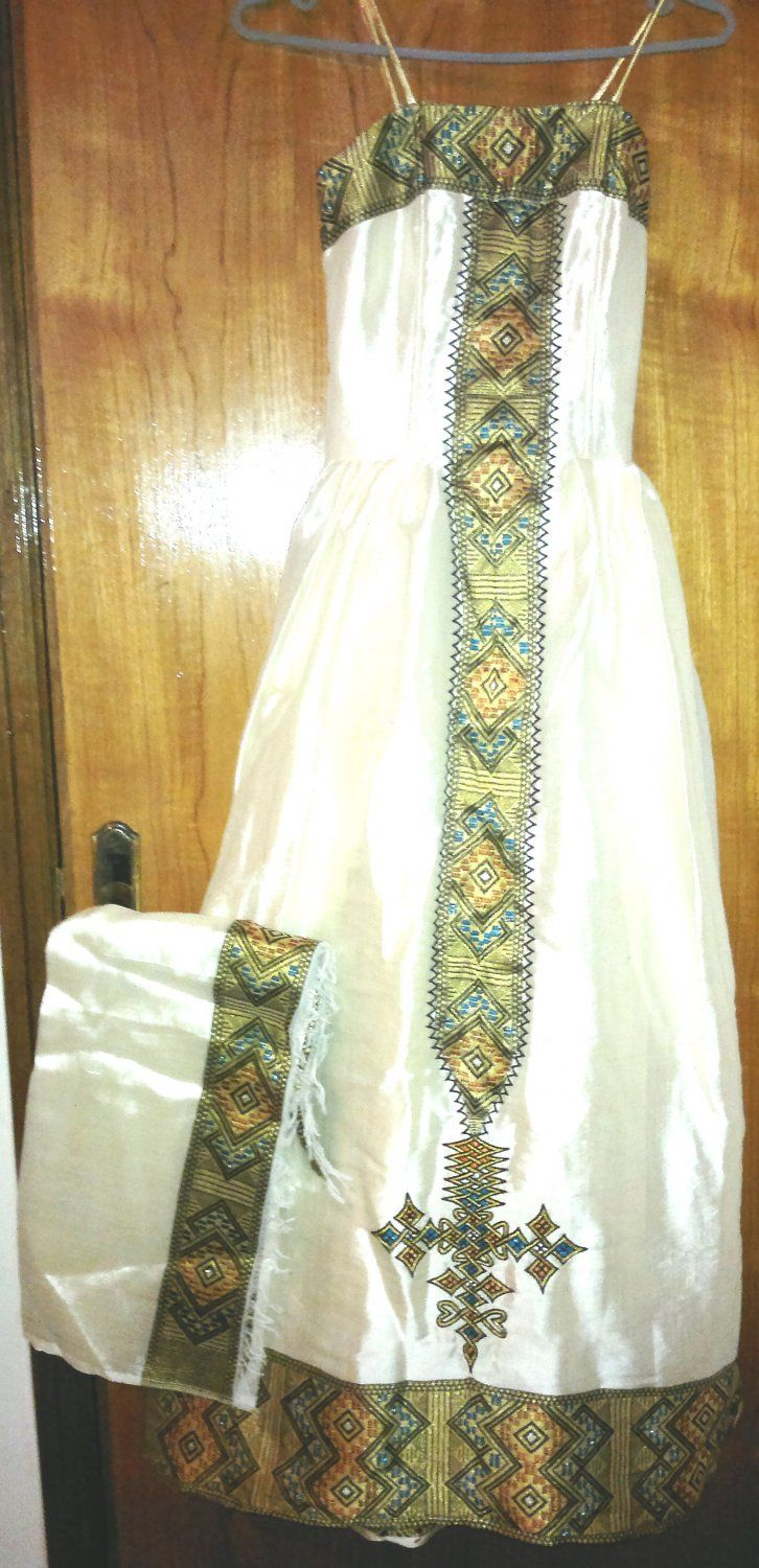 Hand made ethiopian dress with a new design that just came for Ethiopian wedding dress designer