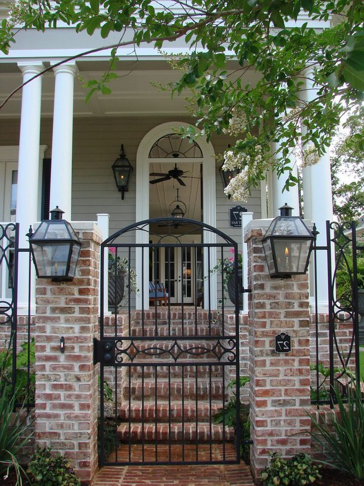 iron and brick fence entry traditional with front entrance outdoor ceiling fans5-