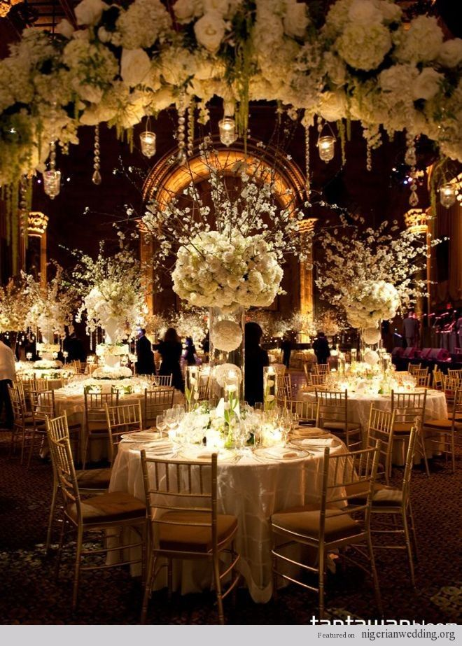 Amazing floral bouquets fill this room with luxurious wedding joy!