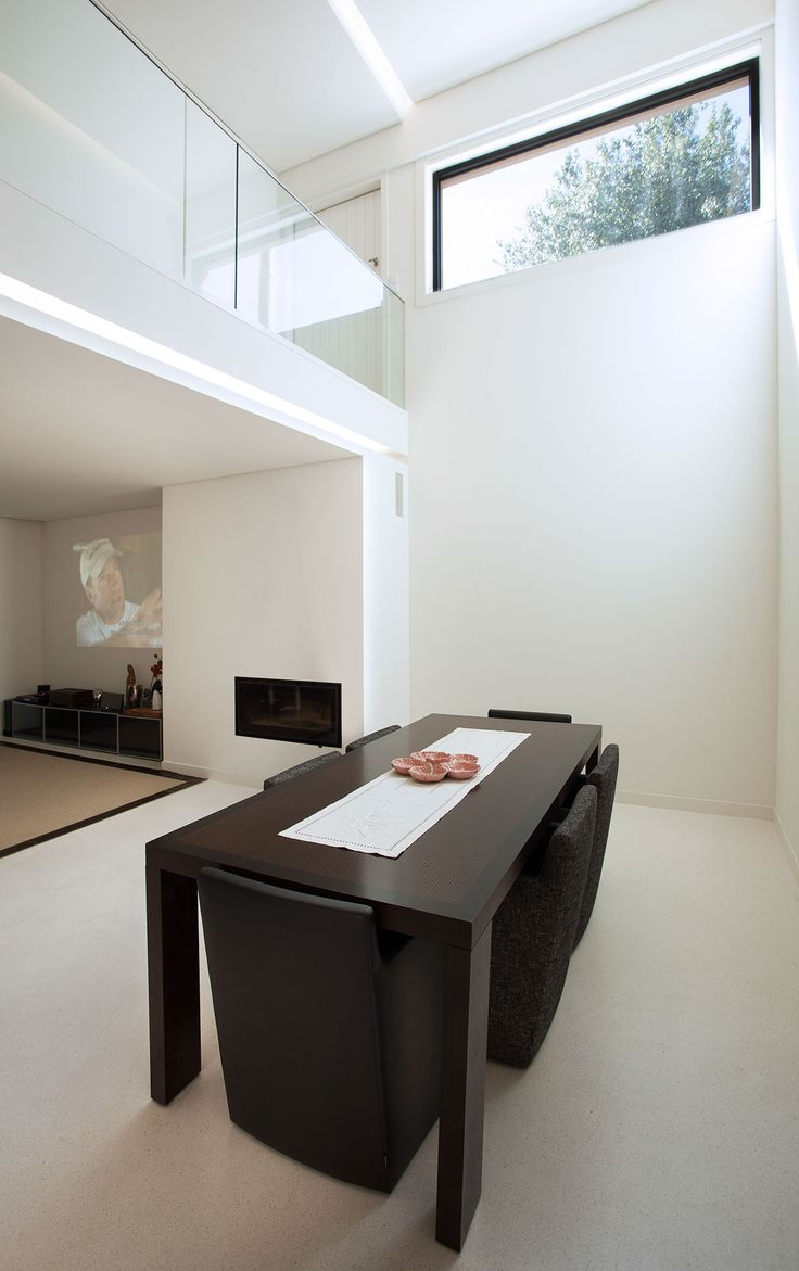 light in architecture,  double height living room by atelier405
