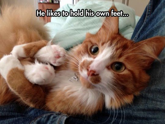 He likes hold his own feet....