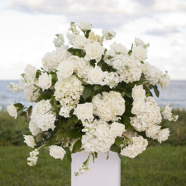 The Ceremony Decor Featured White Hydrangea And Roses At An Ocean View Dewey Seasons Resort Palm Beach Wedding