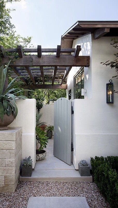 Clean lines, simple pavers and crushed stones excellent for a drought tolerant garden. Inviting entrance to a small porch.