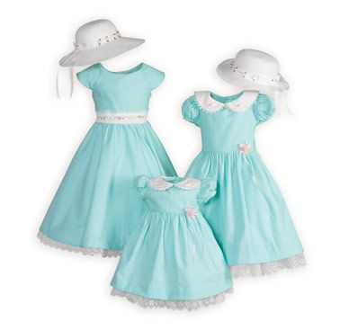 Aqua pima cotton dresses with tiny white dots. Attached slips with embroidered organza lace trim. Button backs. Tie back sashes. Machine wash. USA mad