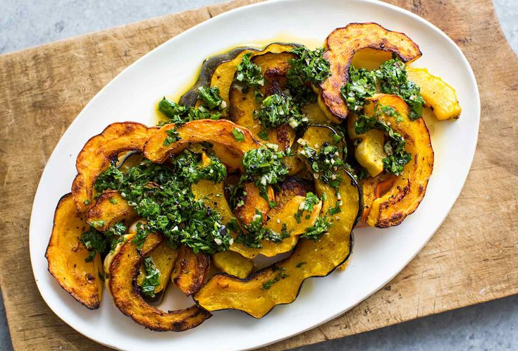 Roasted Winter Squash with Cilantro Chimichurri! Use a mix of squashes, like acorn squash and delicata squash. The cilantro chimichurri makes this simple dish into a showstopper.
