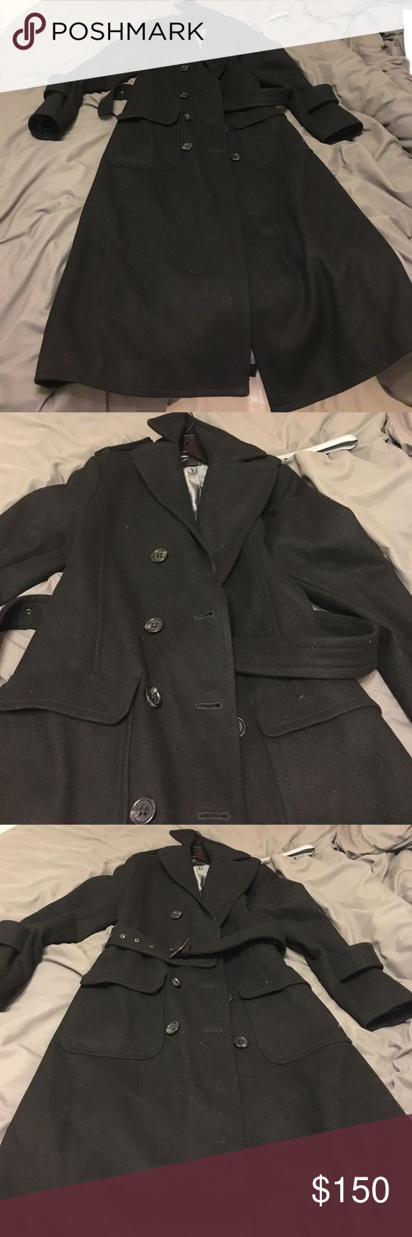 Bcbg MaxAzria trench Worn once black trench coat...there is a minor stain on the inside lining...65% wool/25% rayon/10% acrylic BCBGMaxAzria Jackets & Coats Trench Coats