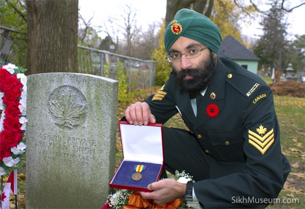 Sergeant Gurpreet Singh Dipak, 23rd Field Ambulance with Pvt. Buckam Singhs Victory Medal at his grave, the only military grave in Canada of a Sikh soldiers from the World Wars.