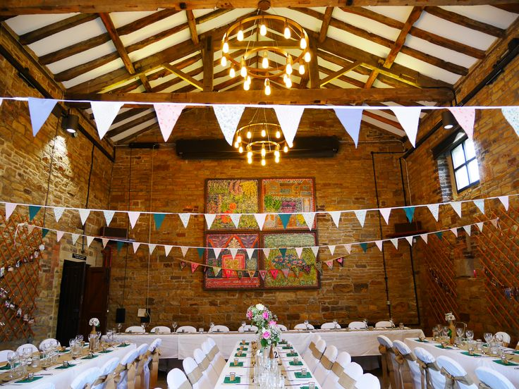 Chair covers by http://www.luxeinlove.co.uk/, all other decorations homemade. DIY Barn Wedding. Oakwell Hall.