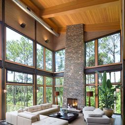 Floor to ceiling fireplace/walls of windows/wood cladding & beams/exposed hvac.