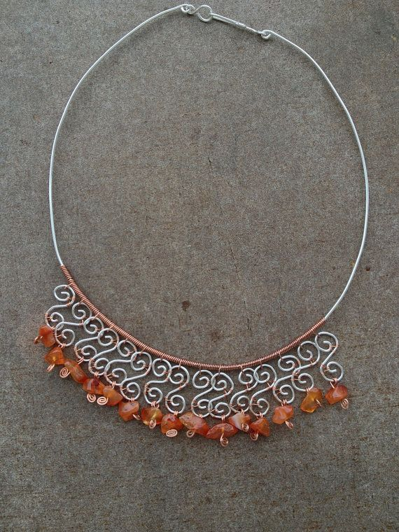 A special necklace, with wrapped copper wire, double silver wire spirals and carnelian gemstones. <br><br>It is lightweight so it can be worn on any occasion. <br><br><> <> <> <br><br>The Carnelian promotes imagination, creativity and concentration. <br>It is a mineral especially recommended for...