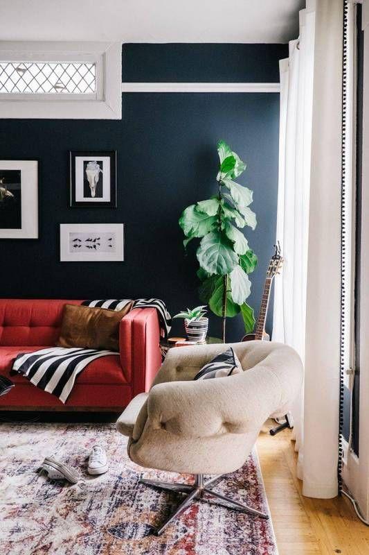 red sofa, dark walls.