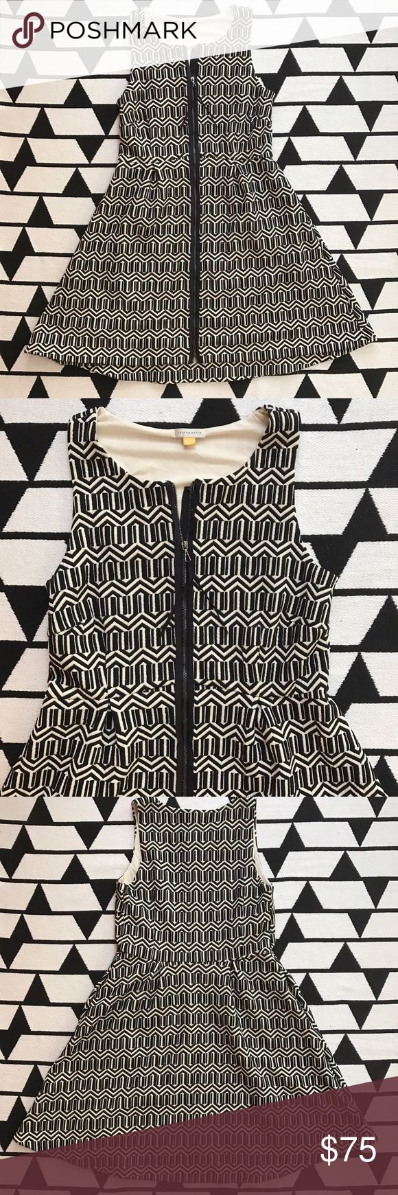 """Anthropologie Black & White Tonnelle Dress By Anthropologie brand Leifsdottir. Textured fit and Flare style. Black and White. Gently used, like new condition with no flaws. Body Length 34.5"""". Bust from armpit to armpit 16"""" (32"""" doubled). Full zip front. Fully lined. Exterior: polyester/rayon/spandex. Lining: polyester. *No trades or modeling. Offers welcomed. Anthropologie Dresses"""