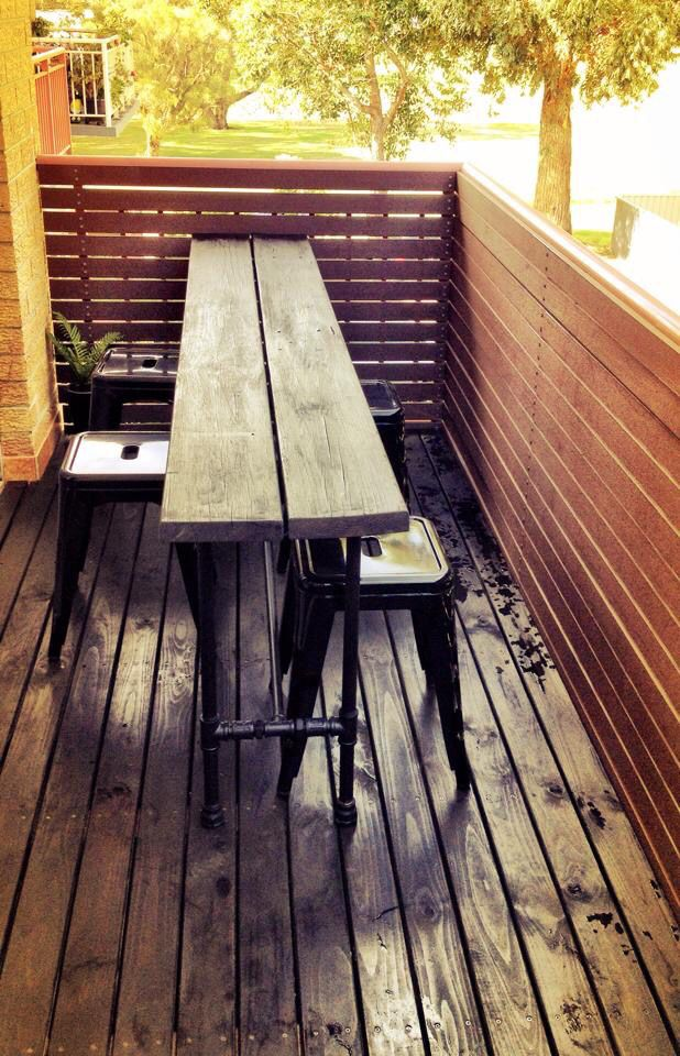 Pine table with galvanised plumbing pipe legs