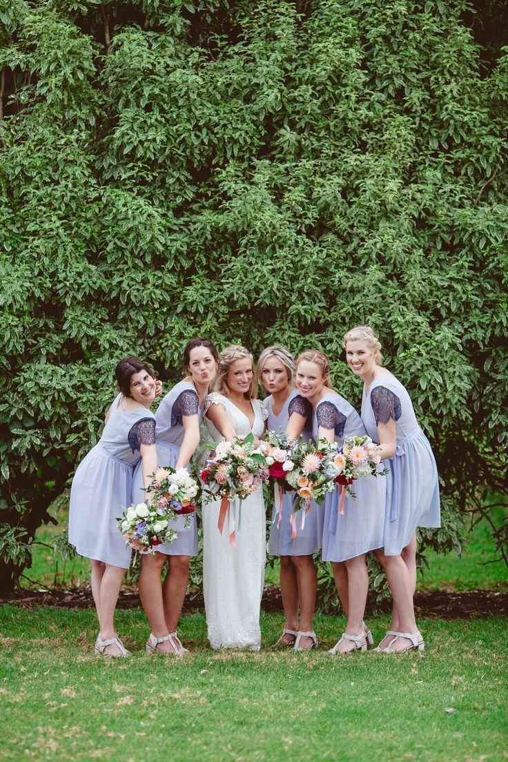 Bridesmaids wearing the #Amelia dress in pale blue by Sally Eagle. #bridesmaids #sallyeaglebridal #wedding #lace