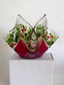 This is a fused glass Christmas candle ,4.5 inches high and 6.25 inches across. set inside is a glass votif candle.