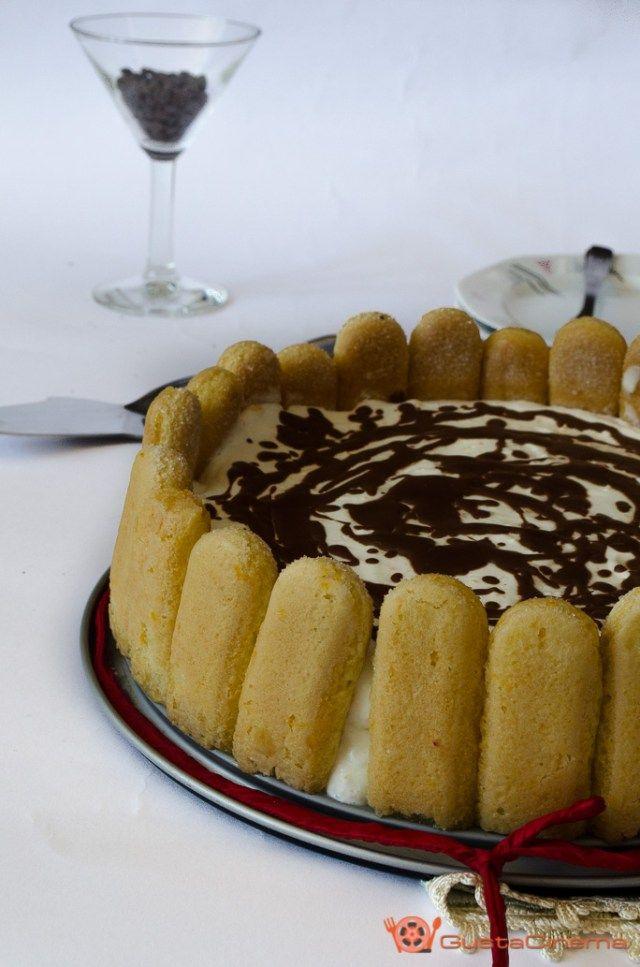Charlotte tiramisù all'arancia e cioccolato un dessert leggero e profumato. Una torta bella da presentare in un'occasione speciale.