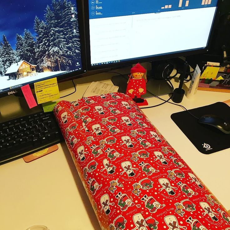 You know it's been a crazy week at work when you wrap presents on your desk while on a break... #graphicdesigner #office #christmasiscoming #presents