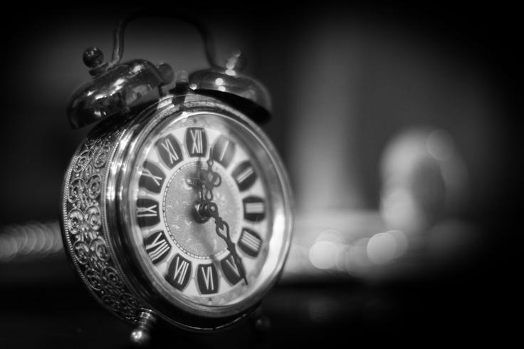 The small alarm clock.