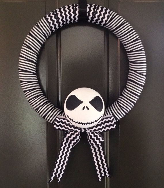 JACK SKELLINGTON WREATH    Everybody scream in our town of Halloween!    This 14 wreath is wrapped with yards and yards of black and white