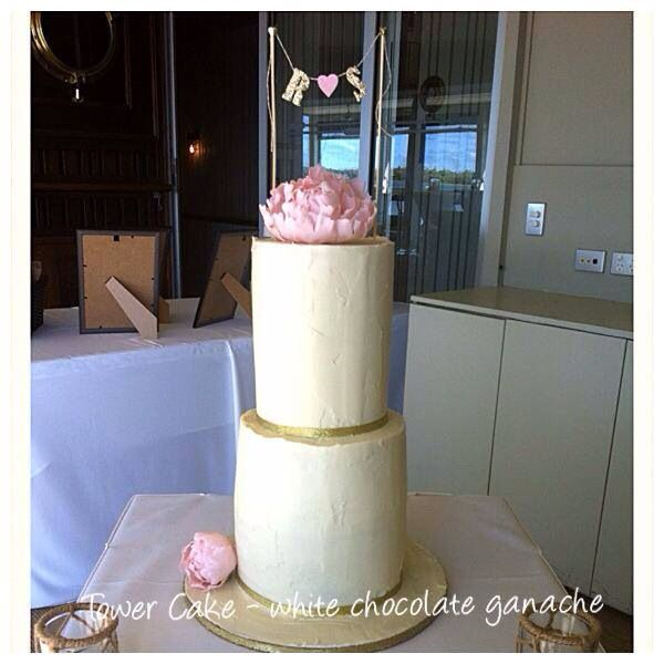 Tower cake ganached in white truffle...4 cakes in 2 tiers..