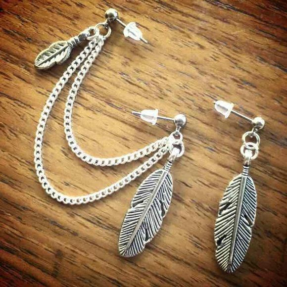 "PRETTIJEWELS.COM  ///  Feather double piercing earring leaf Brand new ⭐️ FIRM PRICE ❌  Feathers are 1"" tall Silver plated chain lengths 3"" & 2 1/2"" Surgical steel hypoallergenic studs Handmade ❤️  ❤️❤️❤️❤️❤️❤️❤️❤️❤️❤️❤️  Earrings jewelry cute boho cartilage piercings wings bohochic nature dream catcher silver leaves Jewelry Earrings"
