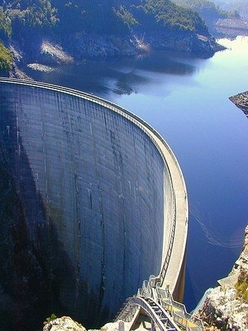 Dam - a bank or wall built across a stream to hold back or redirect water