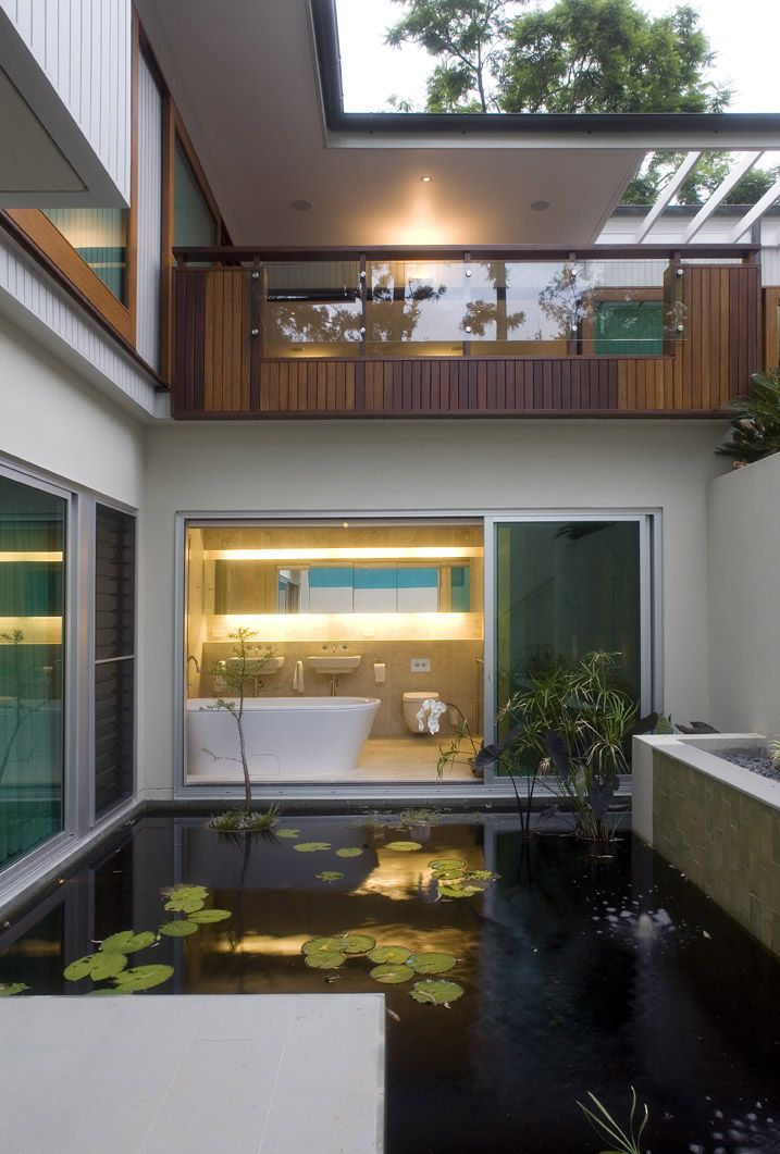 Fig Tree Pocket 2: Indoor-Outdoor bathroom open to pond courtyard. See more at http://blighgraham.com.au/projects/fig-tree-pocket-house-2