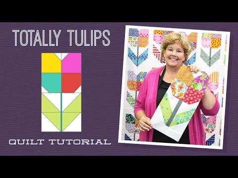 """Click here for supplies: http://bit.ly/TotallyTulip_YT Jenny demonstrates how to make the Totally Tulip"""" Quilt using 10-inch square of precut fabric (layer cakes). She used Tabby Road 10"""" Squares by T"""