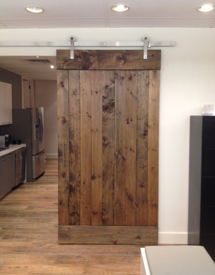 Gorgeous reclaimed wood sliding barn door from True American Grain!