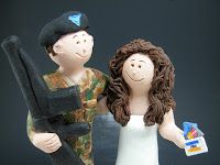 Shopping Bride Wedding Cake Topper by http://blog.magicmud.com $235  1800 231 9814 custom made for a bride who loves to shop and her marine fiancé!....he is well armed with his m16 and attired in his camouflage fatigues....  she is also well armed with a fistful of credit cards at the ready...#marine#shopper#shopping#wedding #cake #toppers  #custom #personalized #Groom #bride #anniversary #credit_cards#birthday#weddingcaketoppers#cake toppers#figurine#gift#wedding cake toppers
