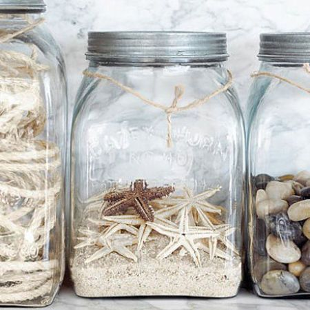 contain yourself. to keep the feel modern and clean put all those beach finds in containers. maybe find some modern ones to keep it edgy.