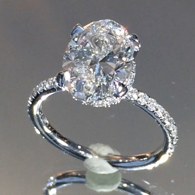 "Dream ring (but with FO moissanite), High quality video of the aforementioned #ovaldiamond ring made for our clients on the left coast. This seductive design showcases a delicate #micropave band with our perfectly placed diamond ""scarf"" beneath the center."