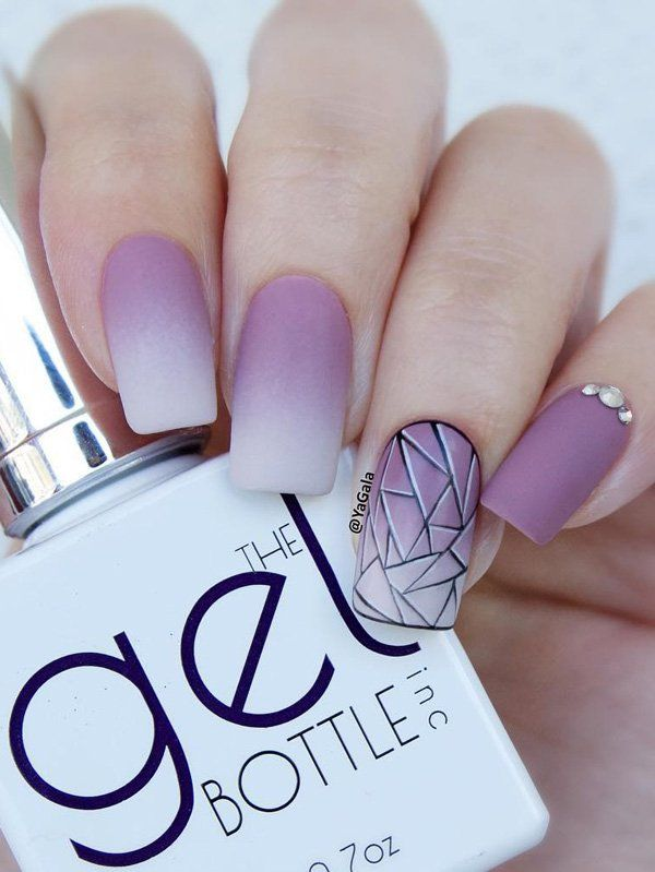 Ombre in pink shade. Geometric shapes like these triangles are what beautify this manicure.