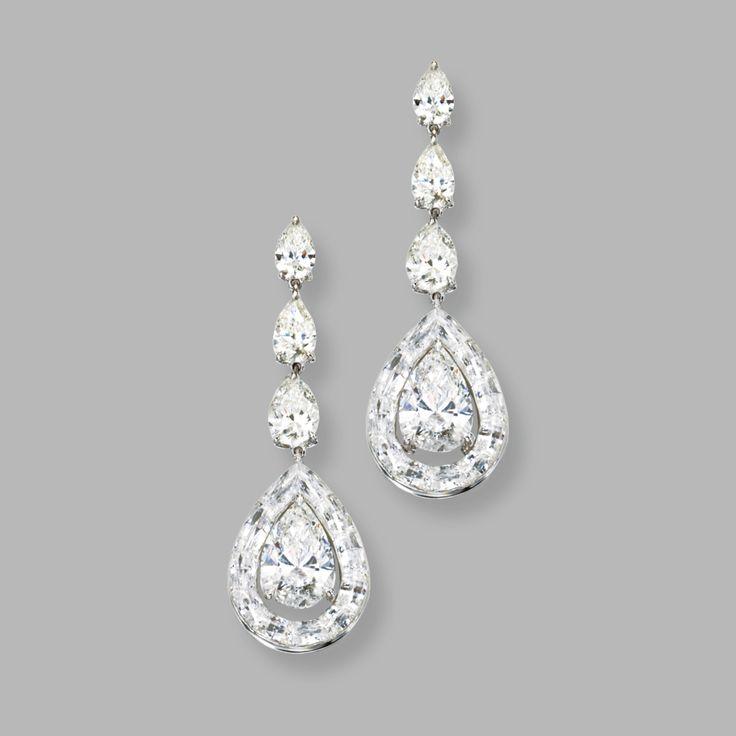 "18 KARAT WHITE GOLD AND DIAMOND ""ENDLESS CUT' PENDANT-EARRINGS, NIRAV MODI The pendants set with 2 pear-shaped diamonds weighing approximately 3.05 and 3.00 carats, framed by 'endless cut' diamonds weighing 6.13 carats, surmounted by 6 pear-shaped diamonds weighing 1.06, 1.03, .70, .70, .50 and .50 carats."