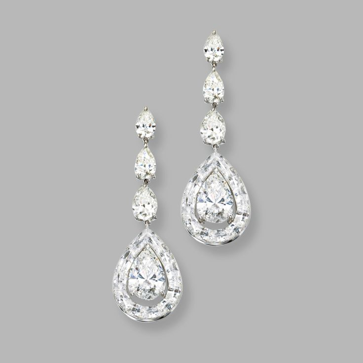 "18 KARAT WHITE GOLD AND DIAMOND ""ENDLESS CUT' PENDANT-EARRINGS, NIRAV MODI The pendants set with 2 pear-shaped diamonds weighing approximately 3.05 and 3.00 carats, framed by 'endless cut' diamonds weighing 6.13 carats, surmounted by 6 pear-shaped diamonds weighing 1.06, 1.03, .70, .70, .50 and .50 carats."