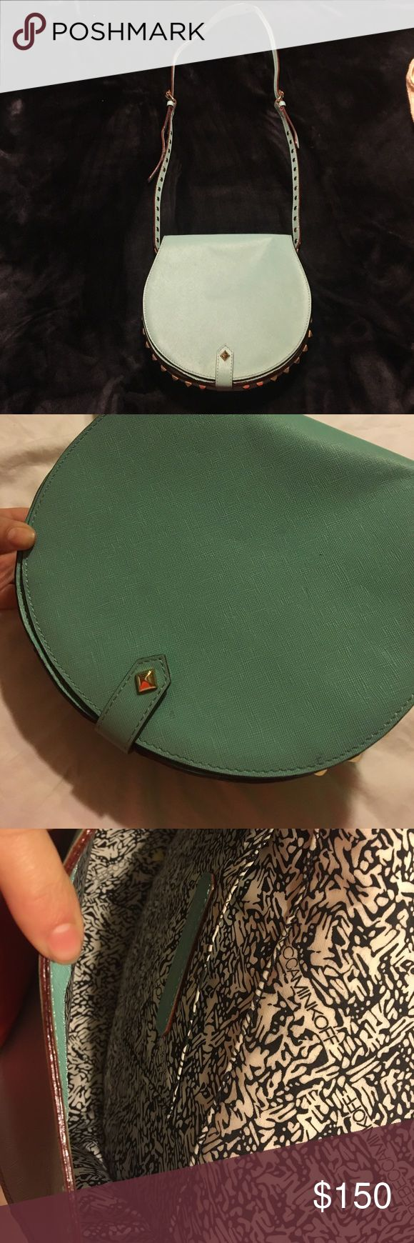 Rebecca Minkoff cross body bag A light blue/ seafoam blue medium sized bag with studs. In very good condition. Has 3 spots but very clean. No studs missing.  Bough at Bloomingdales for $300 Bags Crossbody Bags