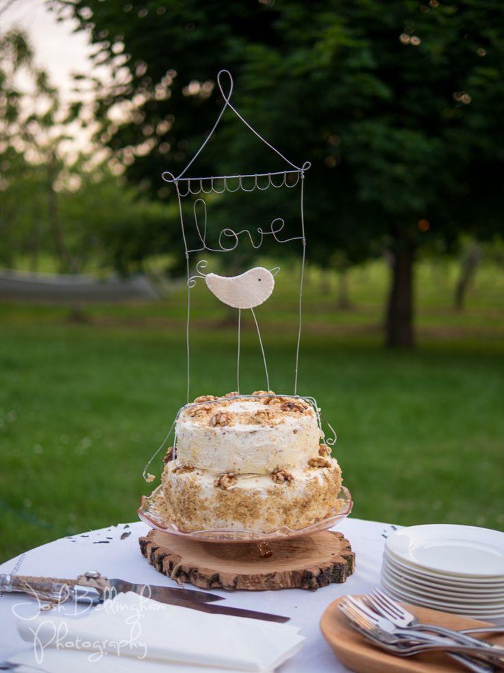 Stunning Rustic Wedding Cake at an Orchard Wedding In Niagara Canada. Beautiful handmade wedding cake by Orchard Croft owner. #JoshBellinghamPhotography