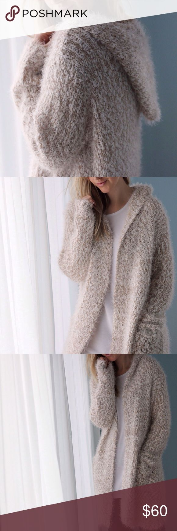 Manhattan Soft Fuzzy Sweater ◽️The Manhattan Fuzzy Soft Sweater is gorgeous and cozy = THE perfect winter piece!  2 roomy front pockets and stylish hoodie. So soft you won't want to take this off! Beige and white blend easily matches most outfits. ❄️Non itchy. Poly. New with tag.  ▫️Sizes available: S/M and L ▫️I am modeling size S/M ▫️Price is firm  Photos are my own Sweaters Cardigans