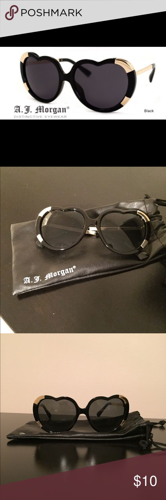 🕶A.J. MORGAN HEART-SHAPED SUNGLASSES 🖤A.J. Morgan heart-shaped sunglasses. Black with gold accents on frame. * Made From High-Quality Injection Mold Plastics * Full UV 400 Protection * Impact Resistant Lenses * Fashionable, Funky and Hip Designer Sunglass Styles Worn but GREAT condition. A.J. Morgan Accessories Sunglasses