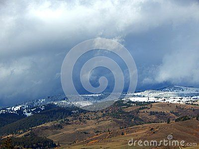 Snowy mountains with cloudy sky, photographed in Romania.