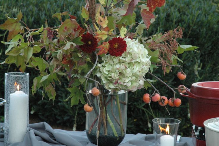 Buffet table large centerpeice with autumn foliage, persimmons, hydrangeas and dahlias from Turnbull Creek Farm