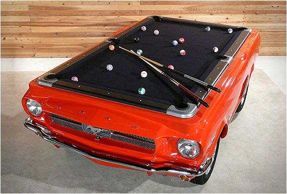 "The table is made from real Ford Mustang parts, complete with working lights, real chrome bumpers, chrome hardware, real alloy rims and tires, and a professional 4 x 8 slate playing top. The front and rear of the table match the cars actual size and are trimmed with real Ford Mustang parts including that cool ""Running horse"" logo."