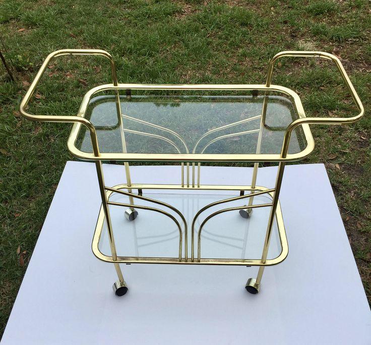 Tea Cart, Brass  Bar Cart, Glass Cart, Brass and Glass Bar Cart,Mid_Century Cart, Two shelf cart, Two glass shelves by BooBoozBazaar on Etsy https://www.etsy.com/listing/523127097/tea-cart-brass-bar-cart-glass-cart-brass