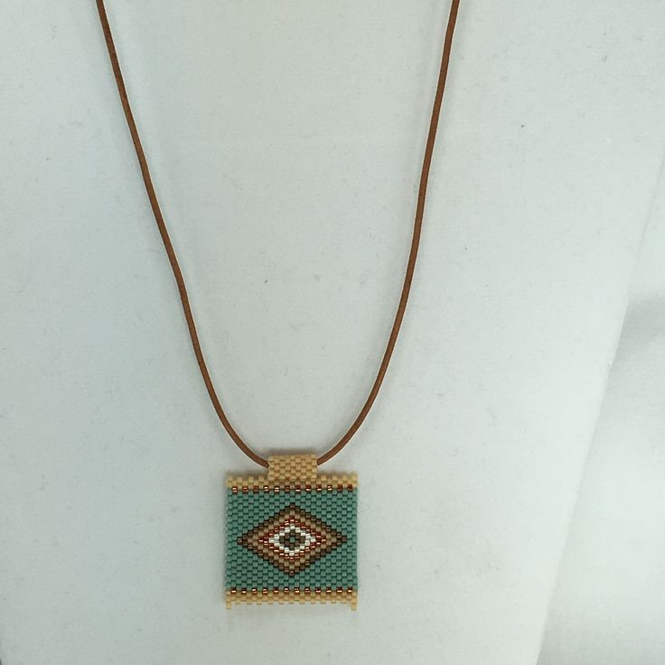 """Peyote stitch pendant on leather with sterling silver hook clasp. 1.25"""" x 1.25"""" Diamond pattern. Can be made to order. All jewelry is nestled in a gift box and bubble wrapped for safe shipping. All sh"""