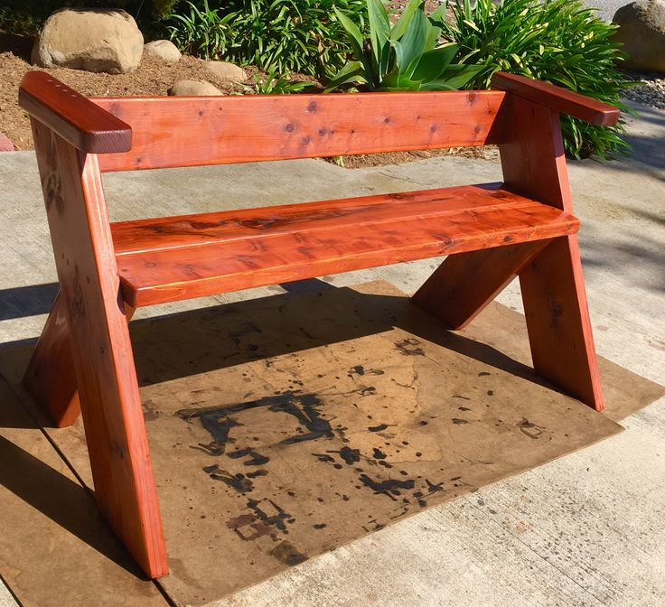 Bocce Ball Bench.  Low back with arm rests.  Redwood with Superdeck 1905 Trans Stain.    GG Colson