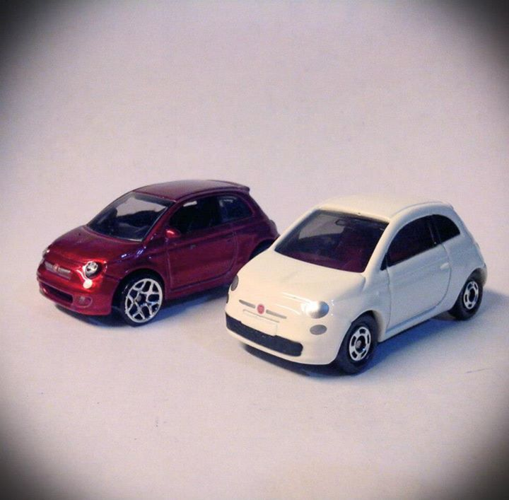 1/64 (roughly) Hotwheels (metallic Red) and Tomica (white) FIAT 500