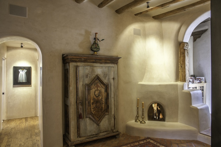 One of my favorite photos from this award-winning remodel from K.M. Skelly, Inc. The armoire was recessed into the double adobe walls, and the plaster walls were refinished by hand.