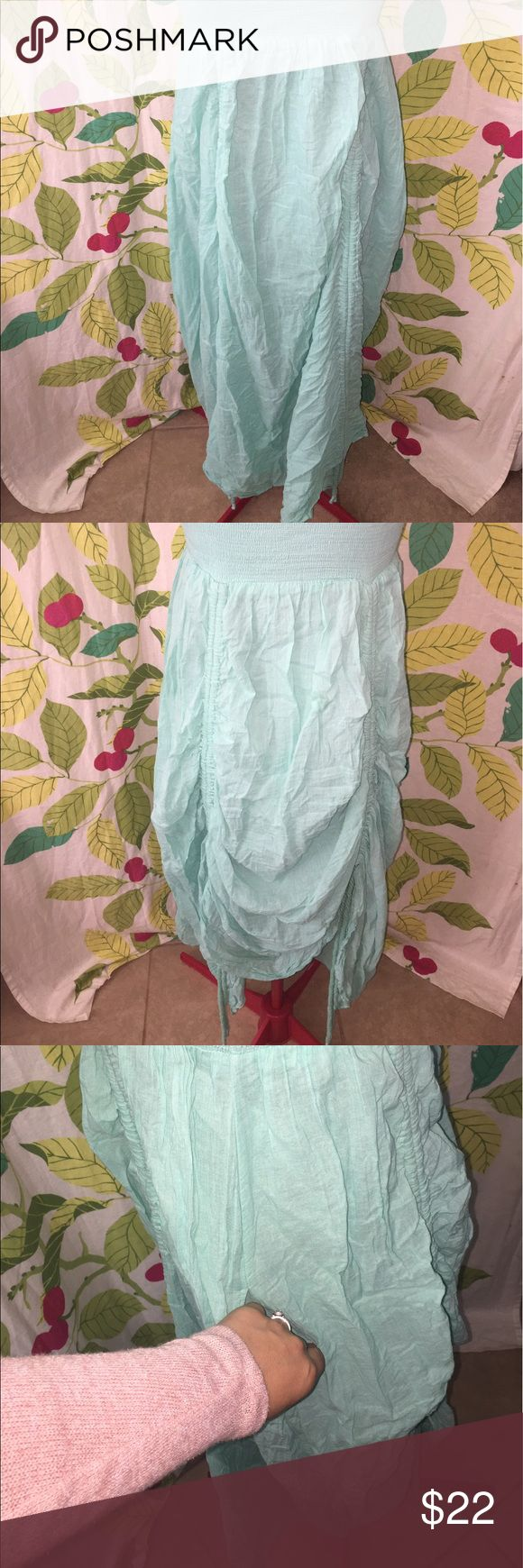 "Anthropologie Adjustable Dress This beautiful dress is so unique. Mint green color is so vibrant. Dress can also be worn as a skirt. Drawstrings up the dress can adjust the fit & length. So versatile. No stains or rips. Cotton. Lined. Bandeau top can stretch up to 20"". Has pockets! 48"" long from top to bottom. Please see my other dresses & skirts. Brand is Lapis from Anthropologie. BUNLDE & SAVE 20%!! Lapis Dresses Strapless"