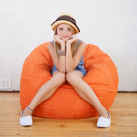 A bright orange bean bag is perfect for lounging / District17.com