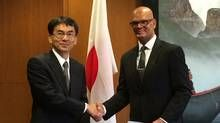 The Canadian Food Inspection Agency's Daniel Miller (right), executive director of the Food Import Export and Consumer Protection Directorate, exchanges letters with Japanese representative Hiroshi Aimoto recognizing the Japan-Canada Organic Equivalency Arrangement. (Supplied)